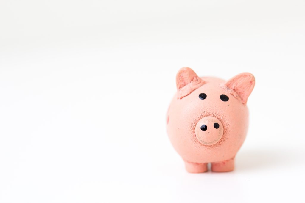 pink piggy bank for saving on title insurance