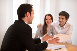 man and couple discussing title insurance