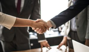 paralegal and client shaking hands-title insurance for paralegals